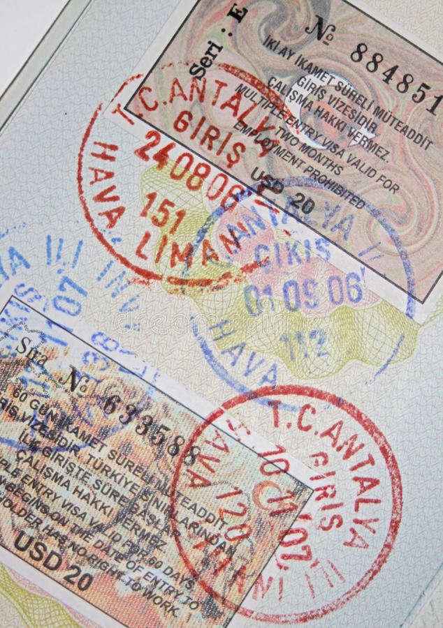 Passport with turkish visas and stamps royalty free stock photo