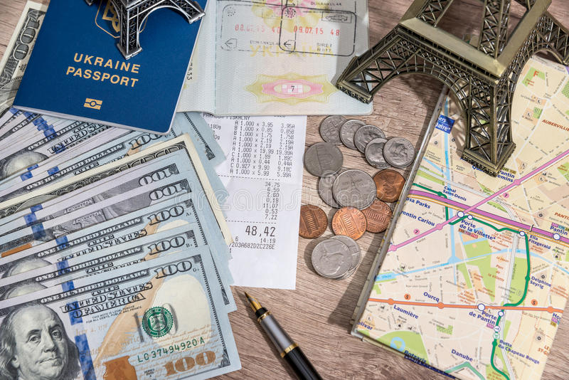 Passport With US Currency And Map Toy Eiffel Tower Check Stock