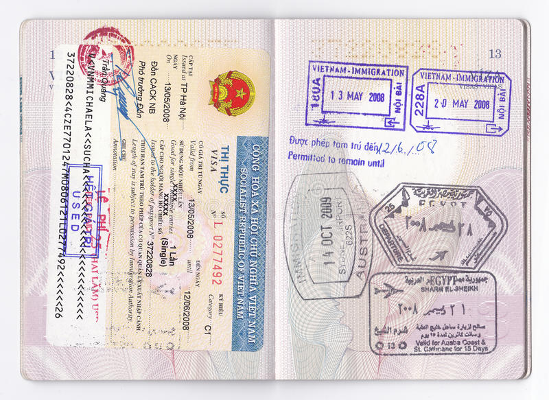 Passport Visa Stamps - Asia, Australia, Africa. Two pages of open european passport with visas for three different countries, for three different continents royalty free stock image