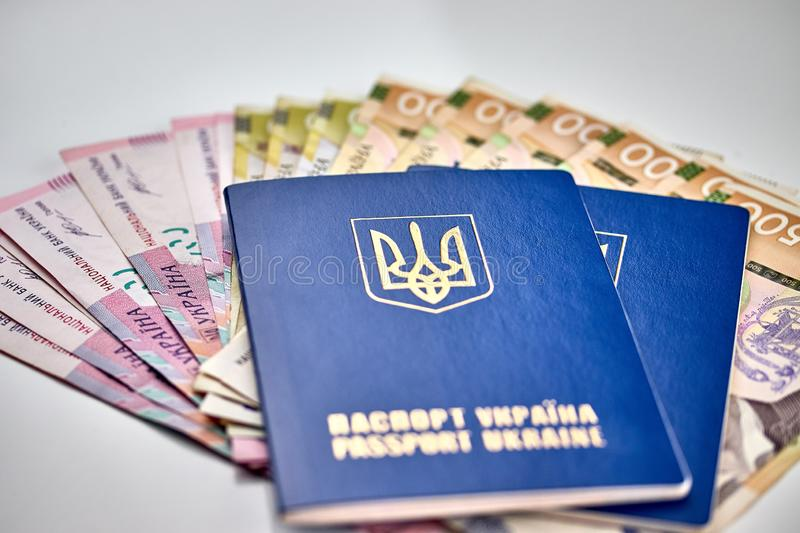 Passports with national currency paper money close up view of cash. On white background vacation election currency exchange voting election finance financial royalty free stock images