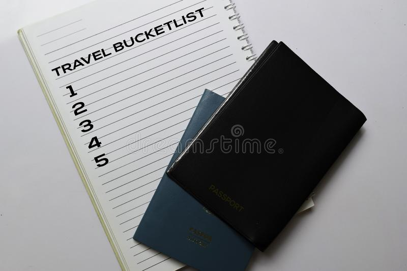 Passports and Travel Bucketlist write on a book isolated white background. holiday concept stock photos