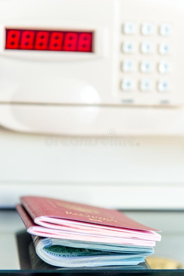 Passports of travelers and money on the background of the safe i royalty free stock photography