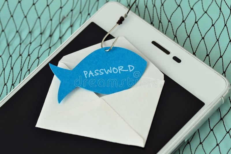 Password written on a paper note in the shape of a fish attached to a hook on an envelope and a mobile phone - Phishing and mobile. Password written on a paper stock photo