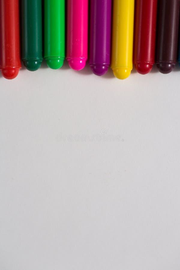 Pastéis coloridos e uma folha de papel, creativit do conceito do caderno fotografia de stock royalty free