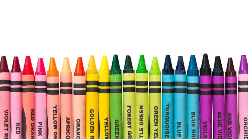 Pastéis coloridos em uma fileira fotografia de stock