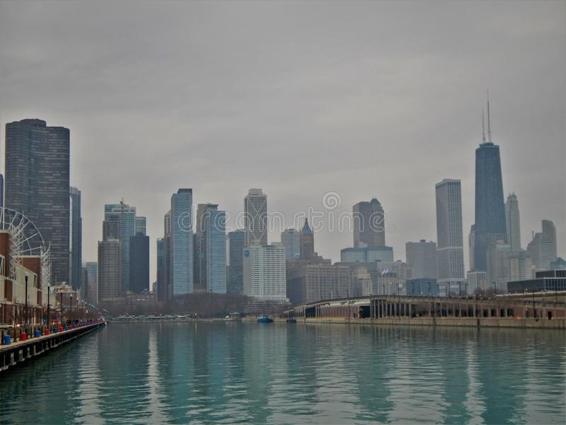 Past the Ferris Wheel and into the City. The famous ferris wheel of Navy Pier is just visible in this photo featuring a segment of the Chicago Skyline royalty free stock images