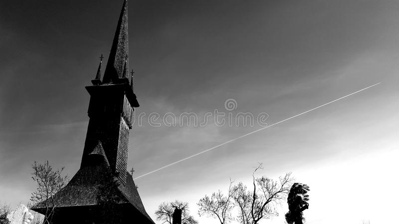 PAST AND FUTURE. The photo captures one of the wooden churches in Maramures, Romania. One of the beauties of southeastern Europe, the church is on the UNESCO stock photos