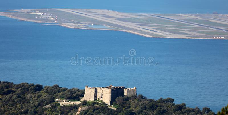 Castle in mountain with modern airport at Nice French riviera, Mediterranean coast, Eze, Saint-Tropez, Cannes and Monaco. royalty free stock photography