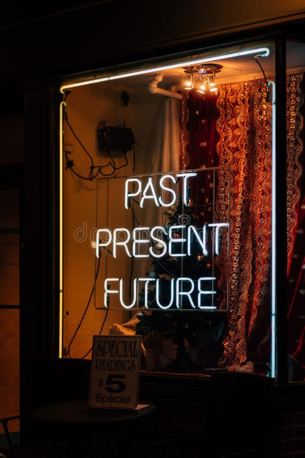 Past, Present, Future psychic neon sign at night, in the West Village, Manhattan, New York City.  royalty free stock photography