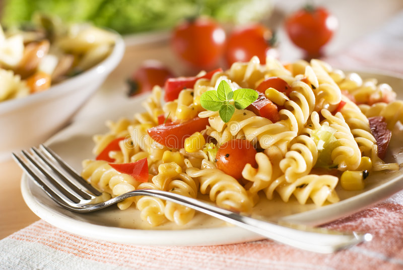 Pasta. Fresh pasta with tomato sauce close up royalty free stock photos