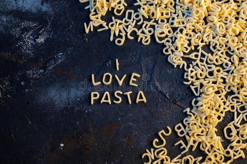 Pasta Alphabet and ingredient for sauce set of ingredients.  stock photography
