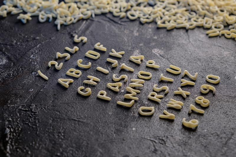 Pasta Alphabet and ingredient for sauce set of ingredients.  royalty free stock image