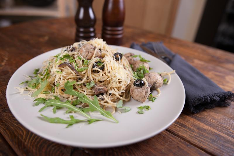 Pasta with anchovies and black olives royalty free stock photo