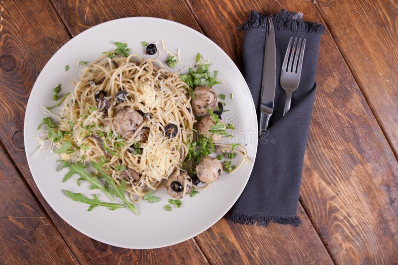 Pasta with anchovies and black olives stock images