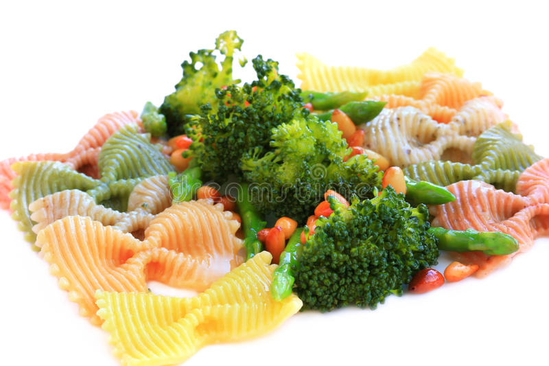 Pasta with asparagus, broccoli and nuts stock photography