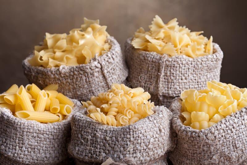 Pasta Assortment In Burlap Bags Royalty Free Stock Image