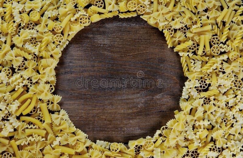 Pasta background - mix of italian pasta on wood stock images