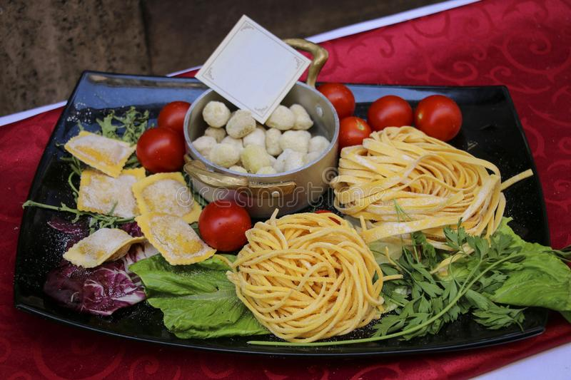 Pasta, basil, tomatoes, lettuce traditional products of Italian royalty free stock photos