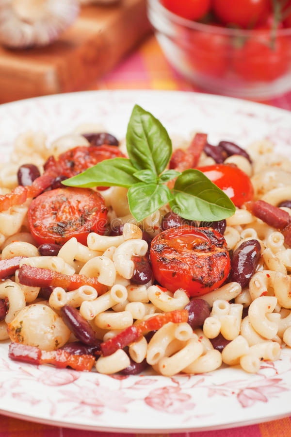 Pasta with beans, bacon and cherry tomato