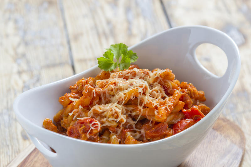 Pasta in a bowl. Pasta with bolognese and cheese in a modern white bowl stock photography