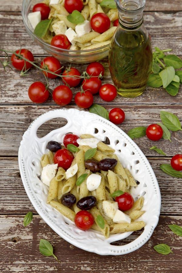 Pasta caprese. Italian Pasta with Caprese salad royalty free stock photography