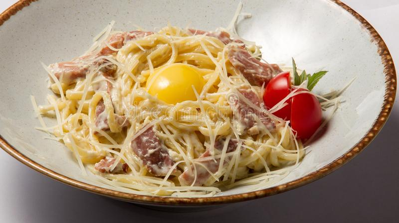 Pasta Carbonara and egg royalty free stock photo