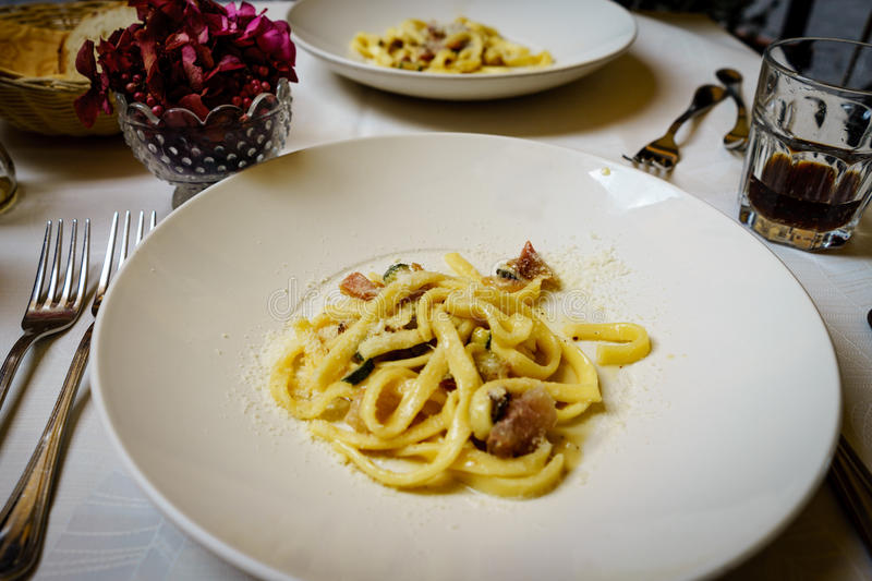 Pasta carbonara. Spaghetti with pork cheek and parmesan cheese royalty free stock image