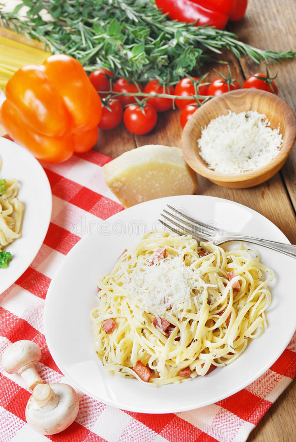 Pasta carbonara on the wooden table royalty free stock photography