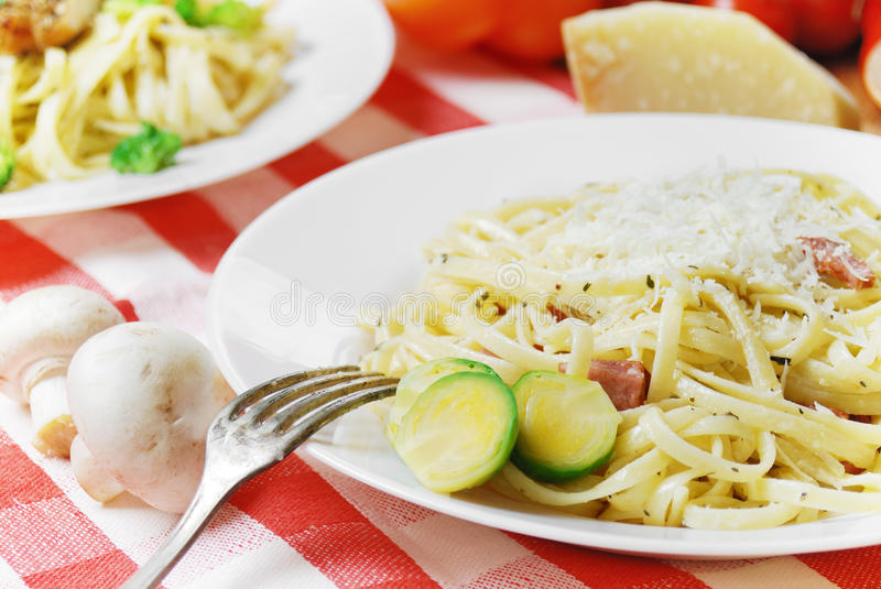Pasta carbonara on the wooden table royalty free stock photos