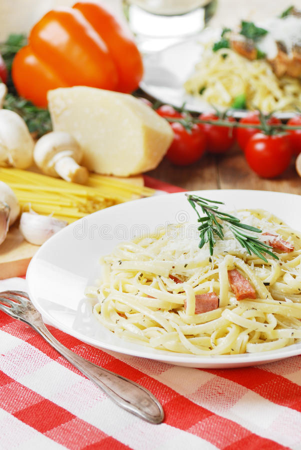 Pasta carbonara on the wooden table royalty free stock images