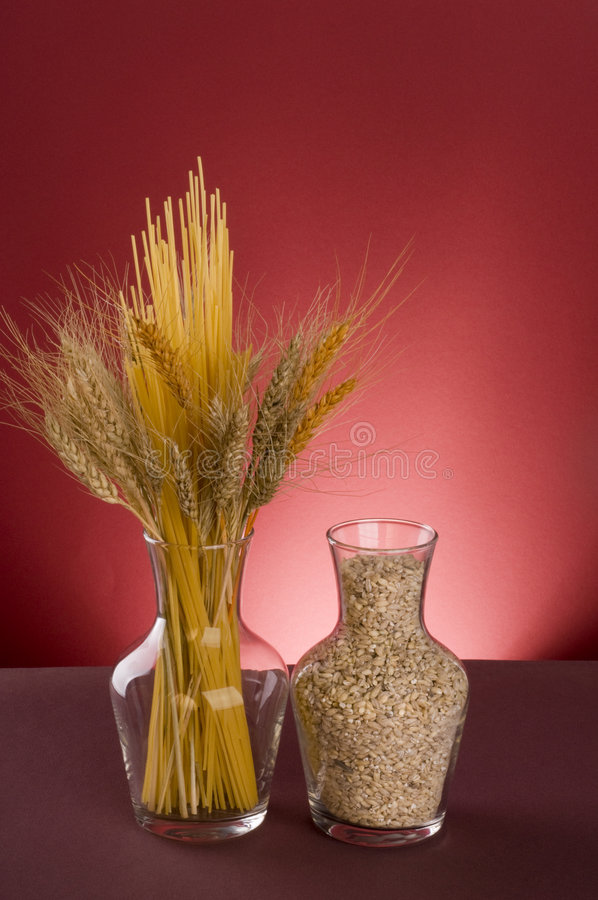Pasta, cereals and grains in bottles. royalty free stock photo