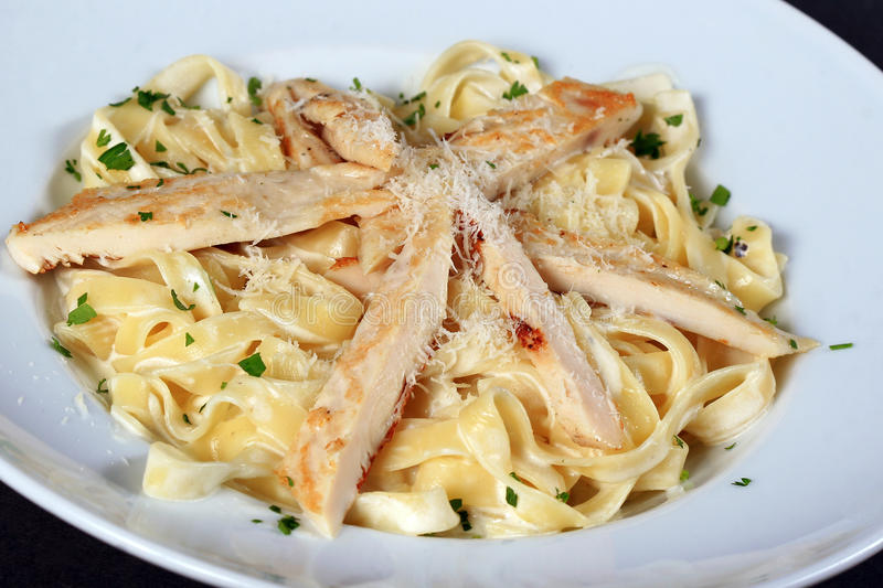 Pasta with chicken pieces stock images