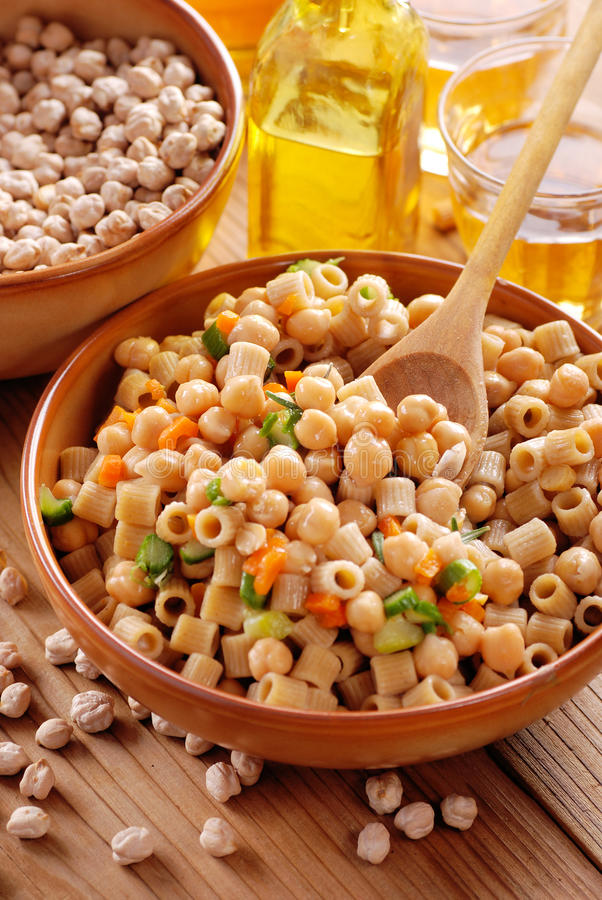 Pasta with chickpeas and vegetables stock images