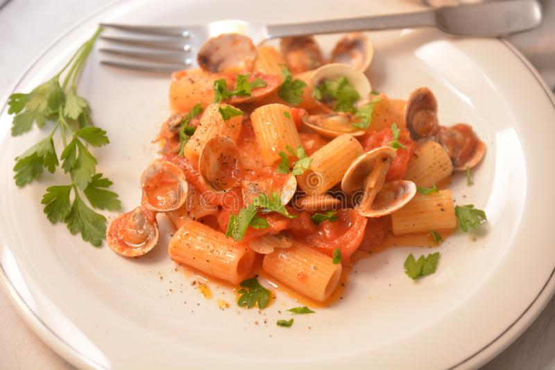 Pasta with clams italian sea food dish gourmet food. Tomato pepper ingredient stock photos