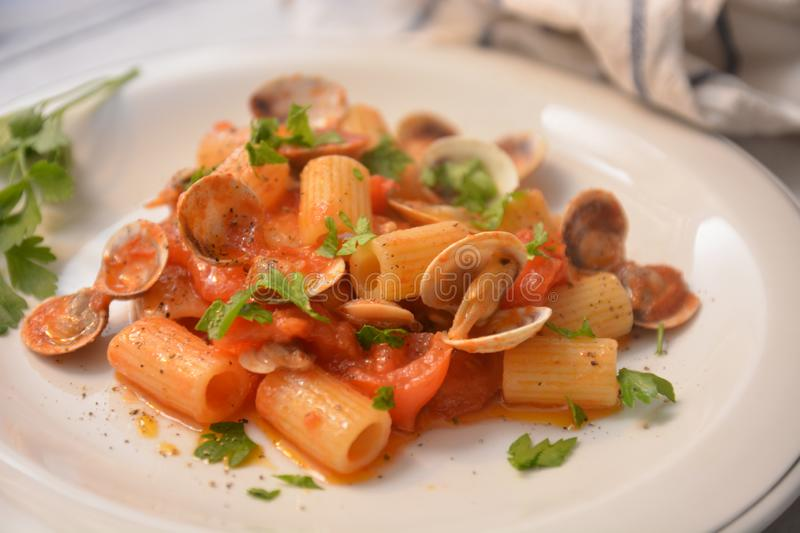 Pasta with clams italian sea food dish gourmet food. Tomato pepper ingredient stock image