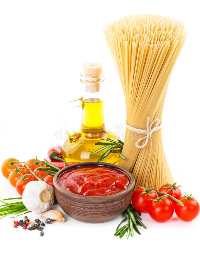 Pasta. The composition of the pasta and vegetables on a white background stock photography