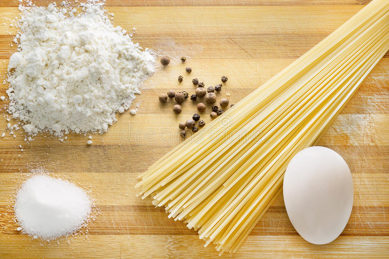 Pasta cooking with flour and eggs royalty free stock photo