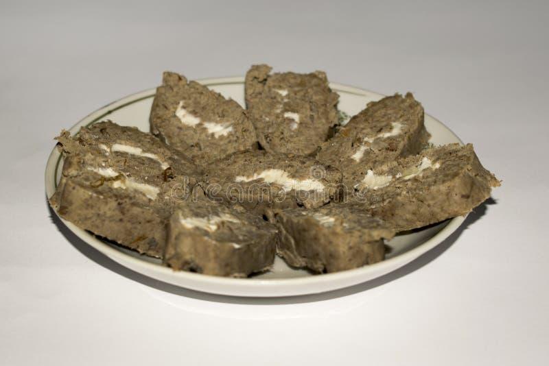 Pasta de fígado caseiro com manteiga no rolo da forma fotos de stock royalty free