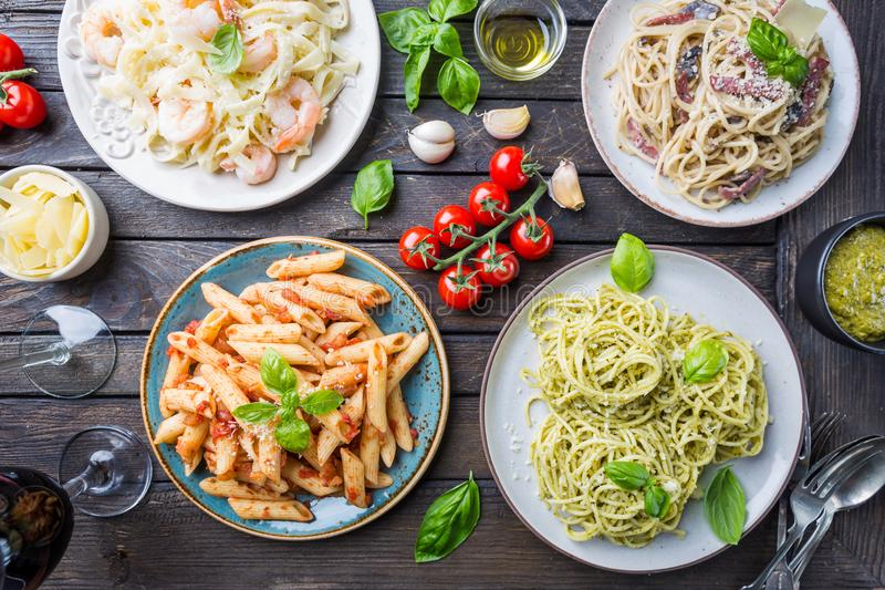 Pasta with different kinds of sauce royalty free stock image