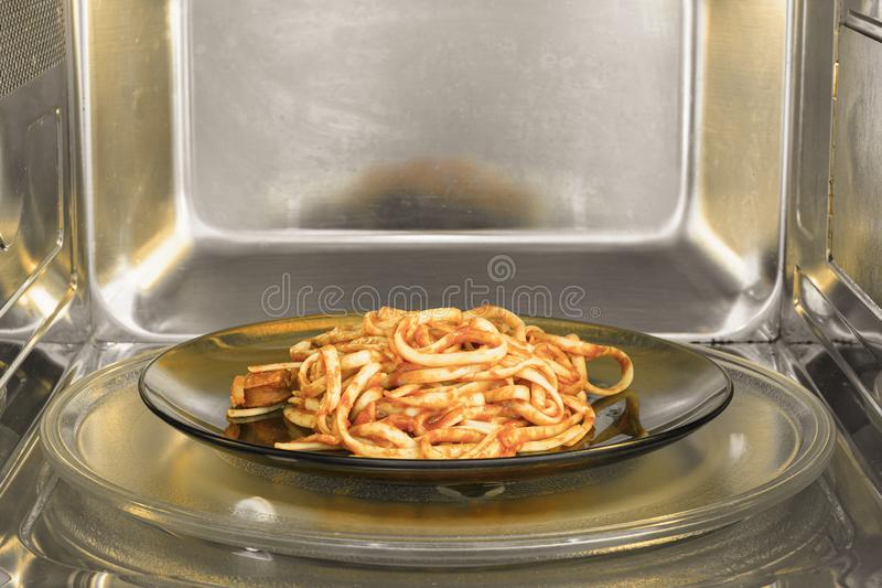 Pasta dish inside the microwave royalty free stock photos