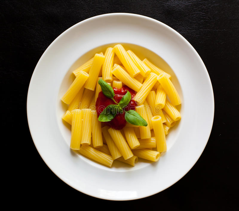 Pasta dish on the plate stock photography