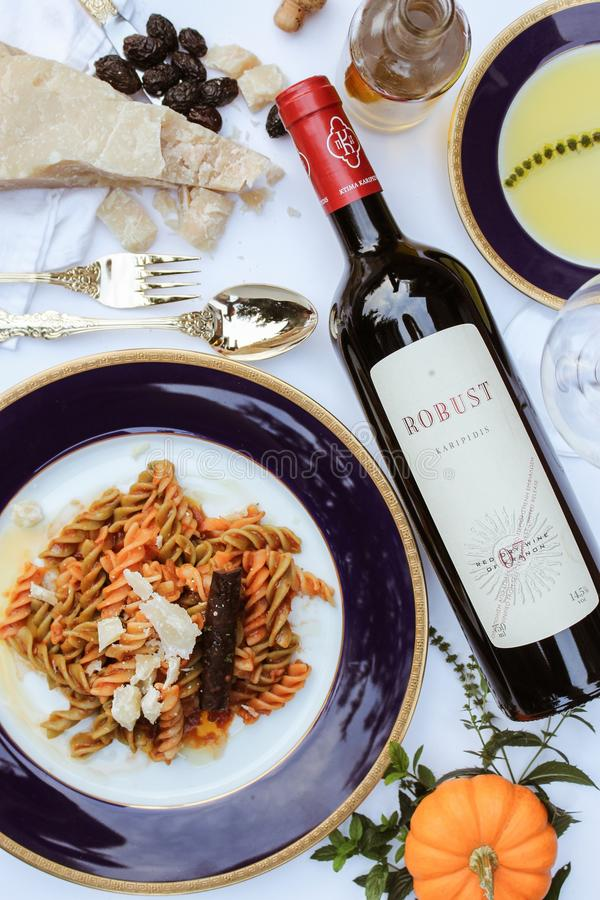 Pasta Dish On Purple Plate Beside Is Robust Wine Bottle Free Public Domain Cc0 Image