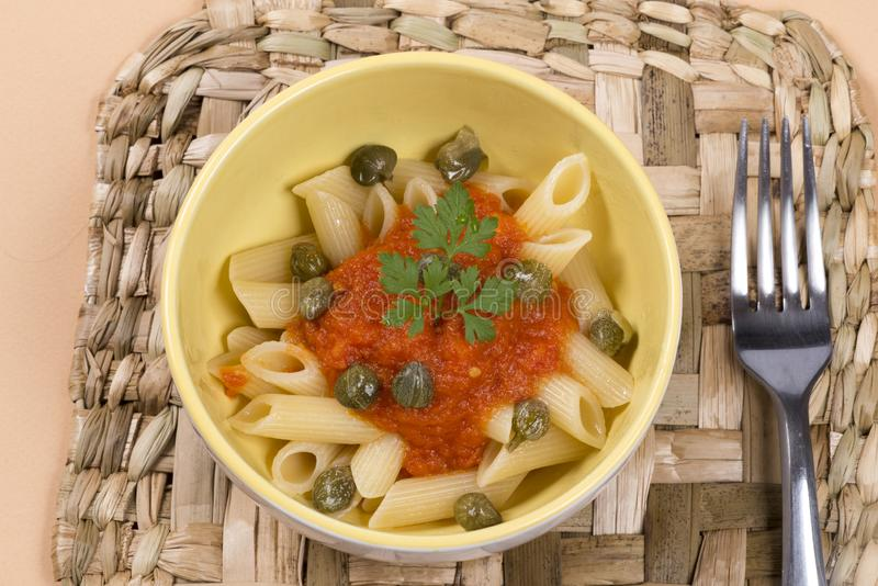 Pasta dish with tomato sauce. royalty free stock photography