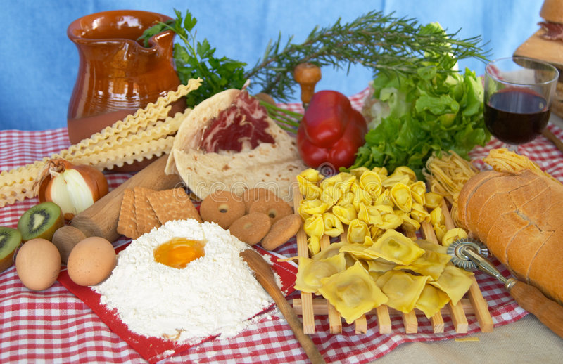 Pasta, egg, flour, biscuits, vegetables, wine royalty free stock photo