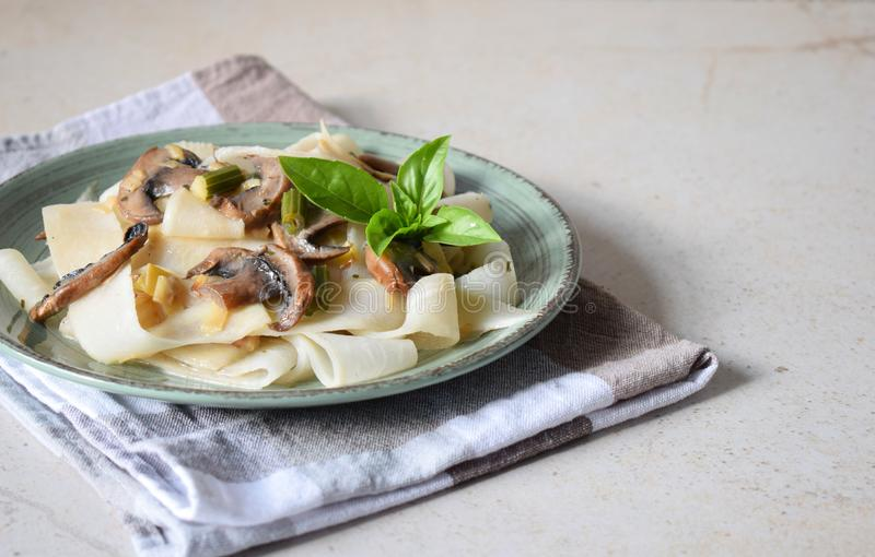 Pasta fetuchini from radish radish with mushrooms and basil. Italian AIP breakfast, dinner or lunch. Autoimmune Paleo. Diet health. Y food concept. Cereals stock image