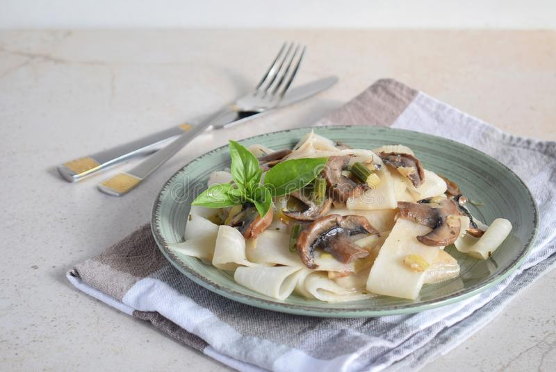 Pasta fetuchini from radish radish with mushrooms and basil. Italian AIP breakfast, dinner or lunch. Autoimmune Paleo. Diet. Healthy food concept. Cereals royalty free stock photography