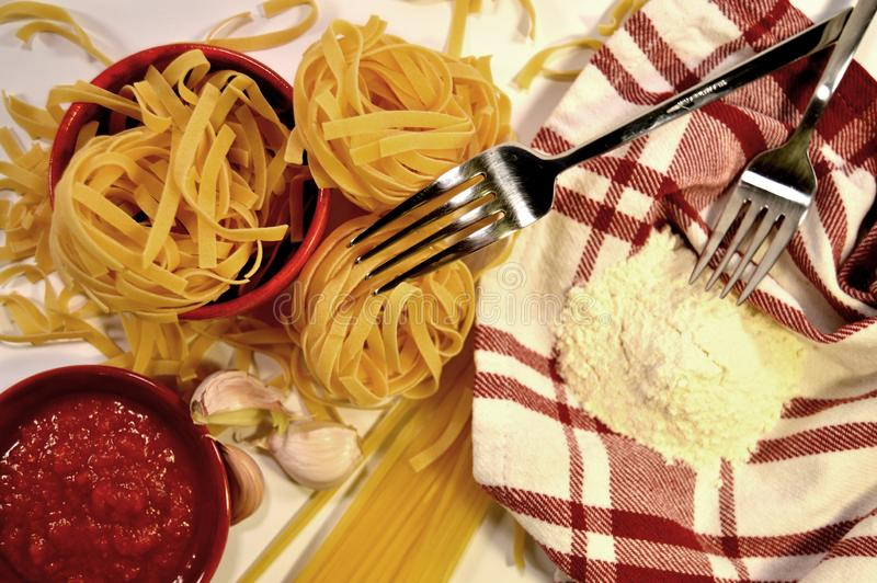 Pasta, flower, tomato sauce and garlic royalty free stock photography
