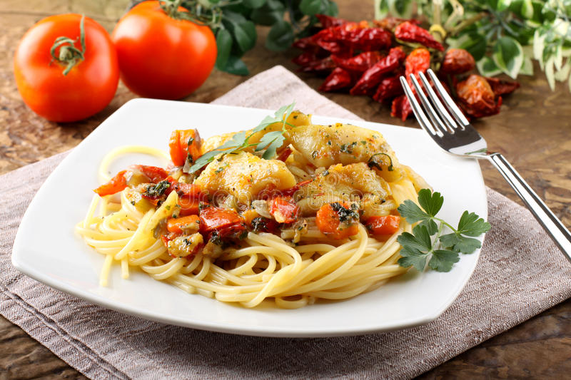 Pasta with fresh grouper fillet. On complex background stock photos