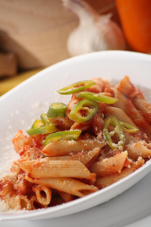 Pasta. Fresh and hot home made pasta with chilli red sauce royalty free stock image