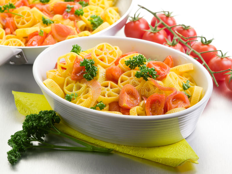 Download Pasta with fresh tomatoes stock photo. Image of dish - 23875080